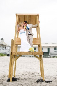 A couple on a nearby lifeguard chair.
